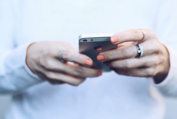 Woman's hands holding a smart phone.