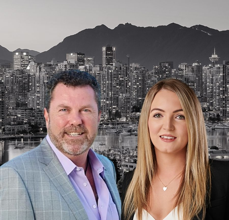 Founder and CEO stand next to each other smiling with Vancouver cityscape in background